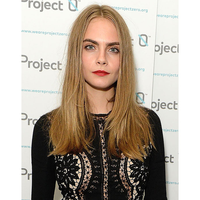 The <em>Paper Towns</em> star had us reaching for the straighteners to recreate this elegant blow-dry hairstyle. Take note from the star and opt for a statement coral lipstick to add a pop of colour. 