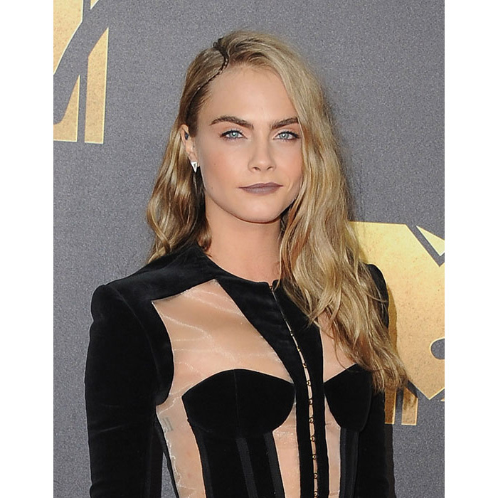 Cara topped best beauty lists at the MTV Movie Awards with her hair left down in sideswept loose waves, paired with a matte complexion and a chic mauve-brown lipstick shade. 