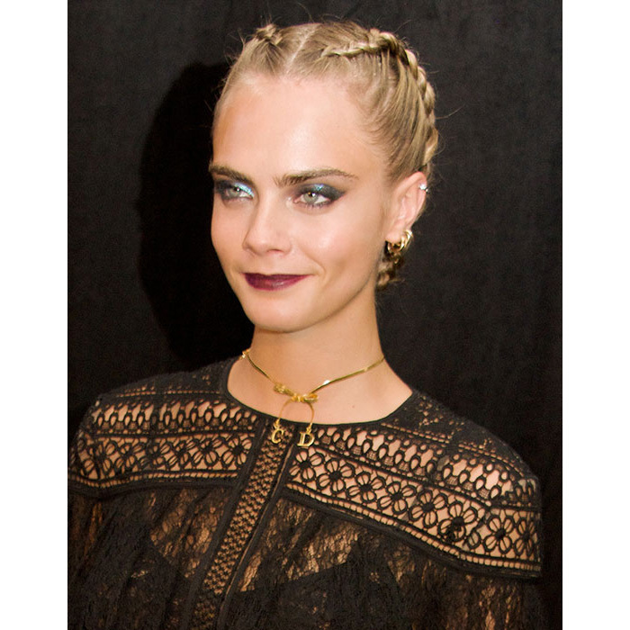 Not one hair was out of place as she mastered the braid hair trend with this bold look, paired with statement shimmering blue eyeshadow and vampy dark berry red lips. 