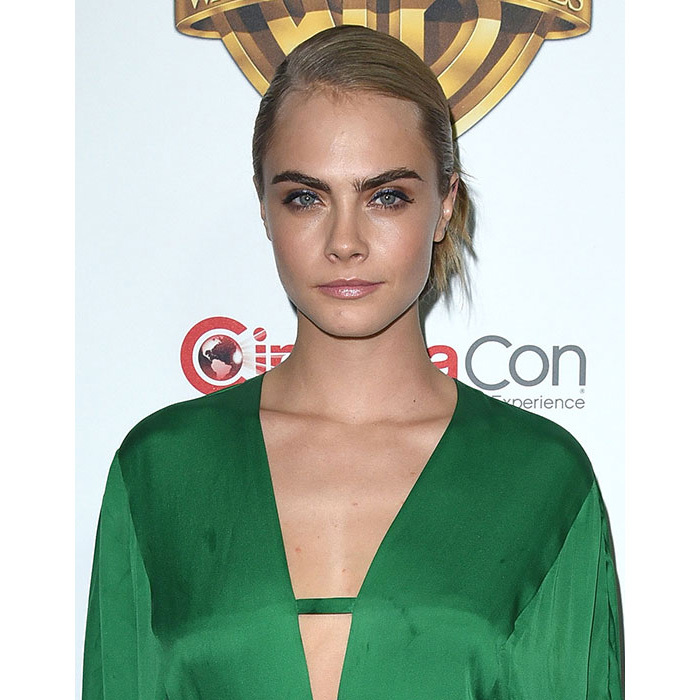 Cara turned heads with this laidback chic look, her blonde locks swept into a loose chignon, adding a pop of colour with peach-hued eyeshadow. 