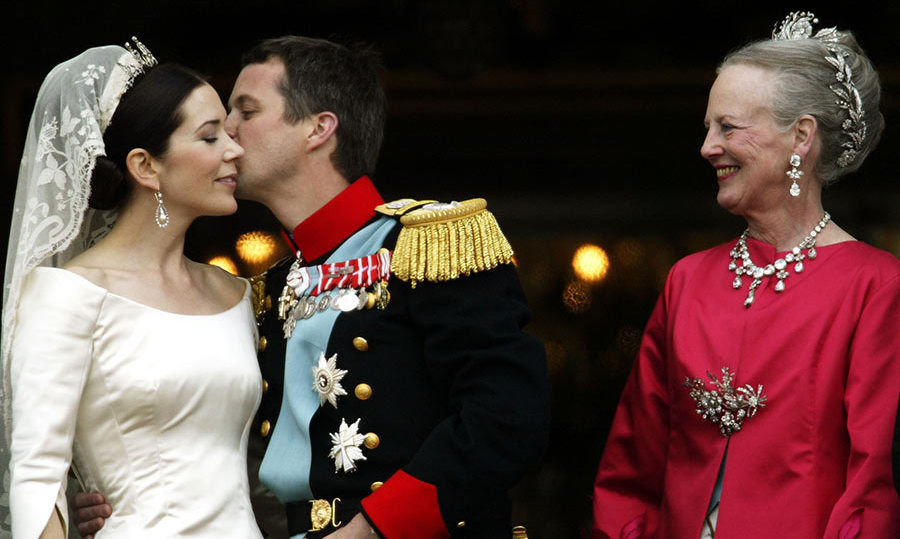 "After saying ""I do,"" the couple paused to kiss as they made they way back down the aisle. They later repeated the romantic moment while on the palace balcony surrounded by their family, including Frederik's mother Queen Margrethe. 
