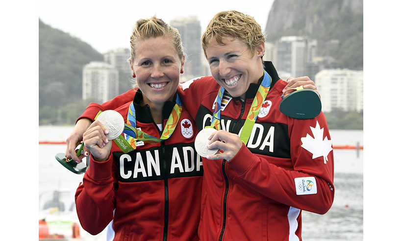 Silver! Lindsay Jennerich (L) and Patricia Obee won Canada's first medal on the water in women's double sculls. <br>Photo: Damien Meyer/AFP/Getty Images