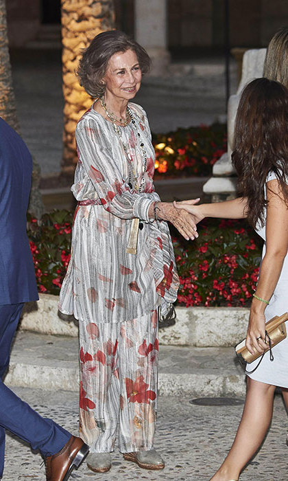 Former Queen Sofia made a statement in flowing floral trousers and a matching blouse.