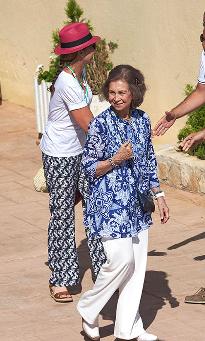 The royal looked casual in white linen trousers and a bold blue blouse as she enjoyed a day out.