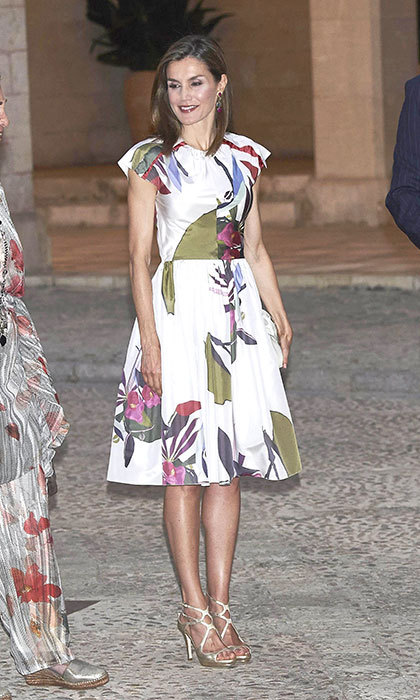 Queen Letizia stole the show in a bold floral dress and metallic heels as the Spanish royal family hosted a dinner for authorities.