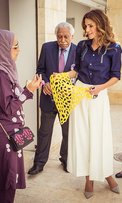Queen Rania showed off her effortless style in white trousers and a navy shirt as she visited the Raghadan Tourist Terminal.