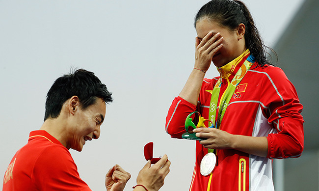 Chinese diver He Zi got more than just a silver medal when her Olympian boyfriend Qin Kai hopped on the podium to ask for her hand in marriage. She said yes!  