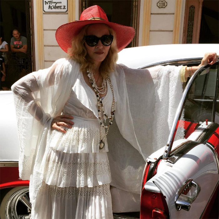 Of course the superstar looked amazing during the trip, and showed off a number of floaty white outfits – each accessorised with a different sun hat!