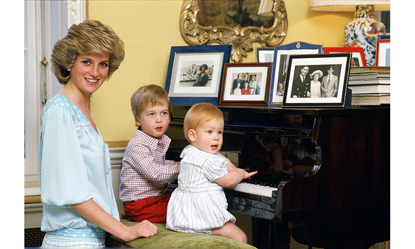 The boys with their mother in the living room of her Kensington Palace home in 1985.