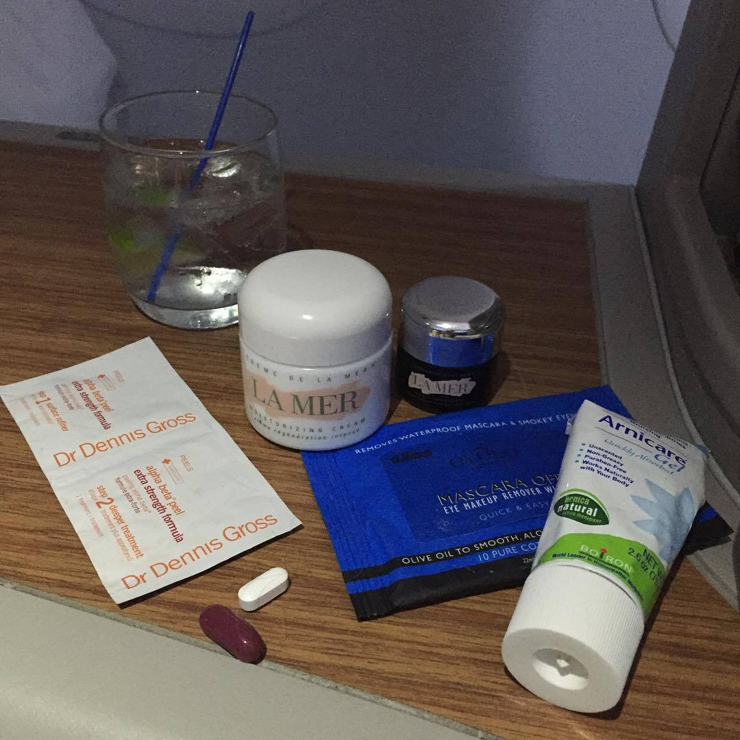 "Chrissy has also managed to capture what it's like to travel like a ""real person."" ""Heading to nyc for #lipsyncbattlelive!!! Baby aspirin, one a day because I'm old, arnica because i am coated in bruises, la mer because I am dry as a bone and peel pads because my skin is made of salt right now. Eye makeup remover and vodka complete the kit.""