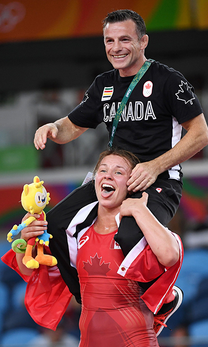 Wrestler Erica Wiebe celebrated her gold medal win with her coach Paul Ragusa. The 27-year-old out-wrestled the competition in the women's freestyle 75 kg event.  