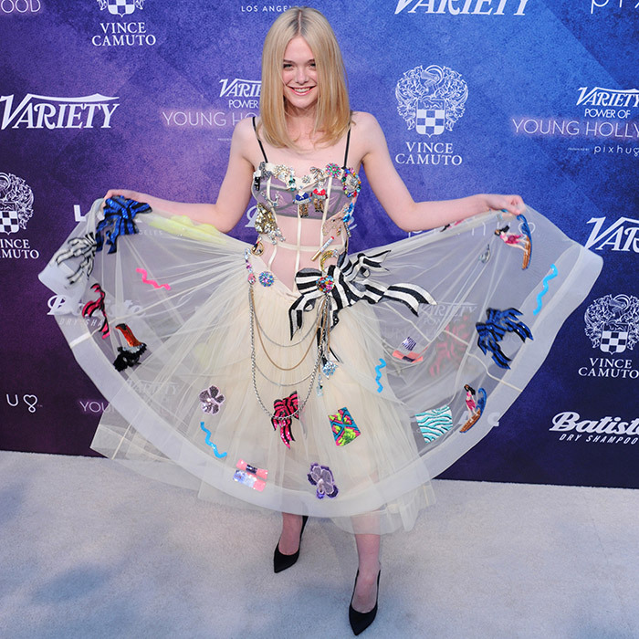 "Elle Fanning couldn't stop gushing over her adventurous Marc Jacobs tea dress at <i>Variety</i>'s Power Of Young Hollywood party in Los Angles. The actress revealed to <i>US Weekly</i> that a certain pop icon inspired her look for the evening. ""I thought, it's like Madonna. It's her birthday today so it's '80s Material Girl. That was the inspiration.""