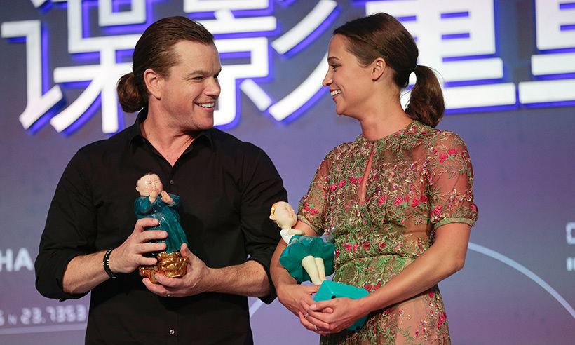 Matt Damon rocked a man bun as he joined co-star Alicia Vikander at a press conference for their film <i>Jason Bourne</i> in Beijing, China. 