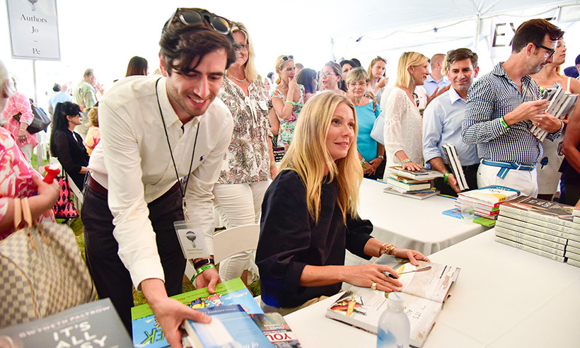 Gwyneth Paltrow's summer in the Hamptons included an appearance at Authors Night For The East Hampton Library. The actress chatted with fans as she signed copies of her cookbook <i>It's All Easy</i>.