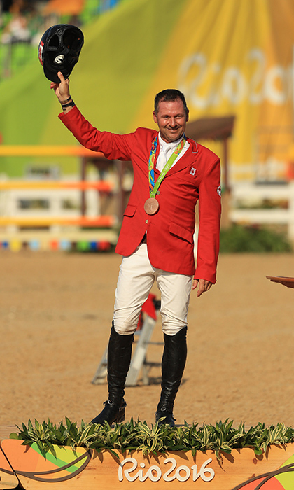 Veteran equestrian Eric Lamaze galloped to bronze in men's individual jumping.