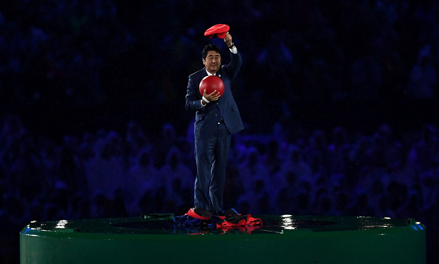 One of the biggest cheers on the night came when Japan's Prime Miniser Shinzo Abe appeared dressed as computer game character Super Mario, rising out of a huge green pipe.