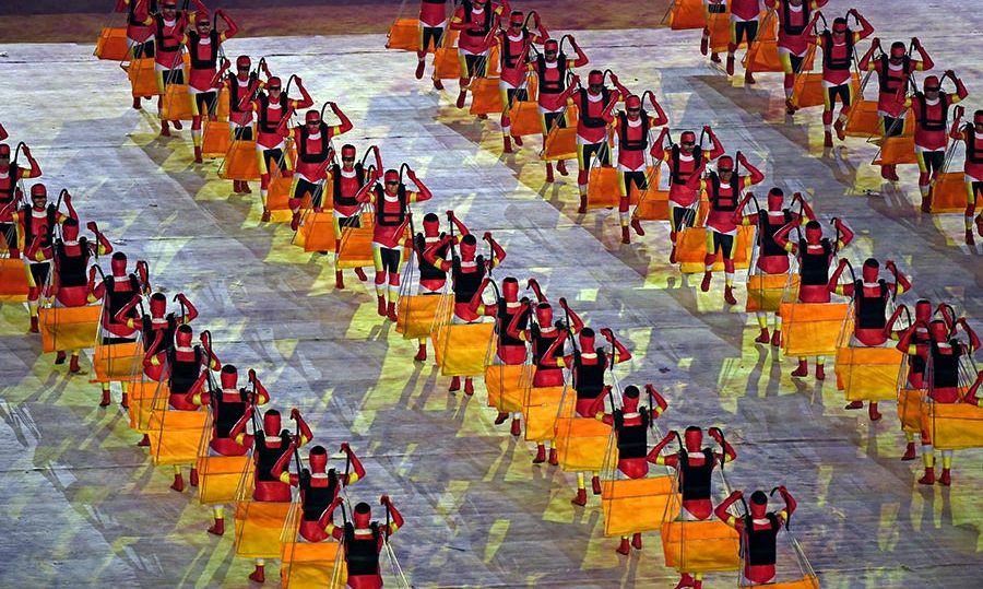 Dancers perform during the 'Art of the People' segment, which paid tribute to local traditions.