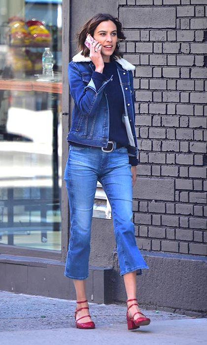 Alexa Chung wears her cropped flares with a shearling collar denim jacket and Mary-Jane flats in New York. 