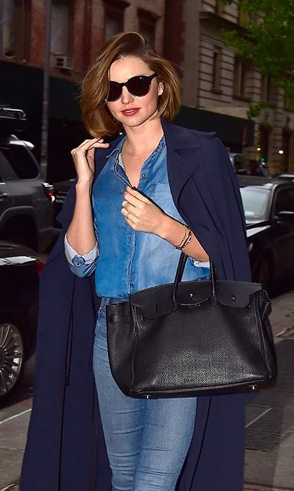 Miranda Kerr tucks a chambray shirt into her skinnies and adds a navy trench for a chic take on double denim. 