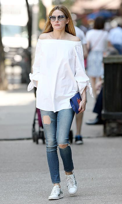 Olivia wears her favourite Tibi shirt with distressed AG jeans, a Diane von Furstenberg clutch, Moncler trainers and Fendi sunglasses. 