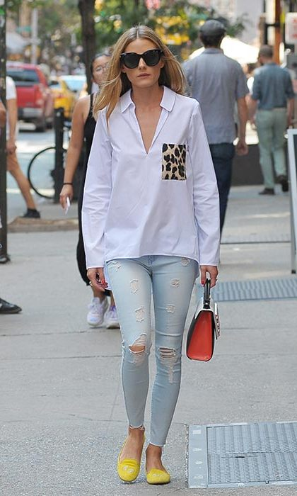 Olivia teams a white Zara shirt (yes, we're snapping it up too!) with Black Orchid jeans, a Les Petites Joueurs tote and monogrammed slippers. 