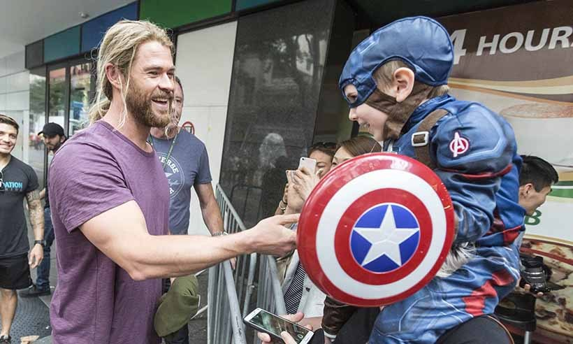 Dad of three Chris Hemsworth took a break from filming the latest <i>Thor</i> film to greet mini <i>Avengers</i> fans in Brisbane, Australia.