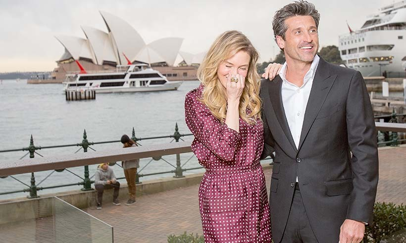 <i>Bridget Jones's Baby</i>'s leading lady Renée Zellweger giggled her way through a photo call with co-star Patrick Dempsey at Sydney Harbour.  