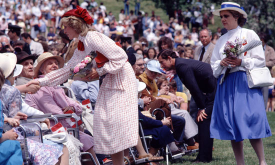 Prince Charles and Princess Diana meeting the crowd in 1985.