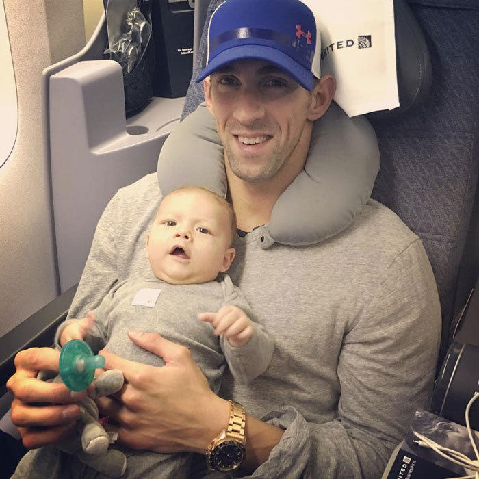 Boomer was twinning with dad Michael Phelps in matching grey ensembles for his flight from Rio back to the United States.