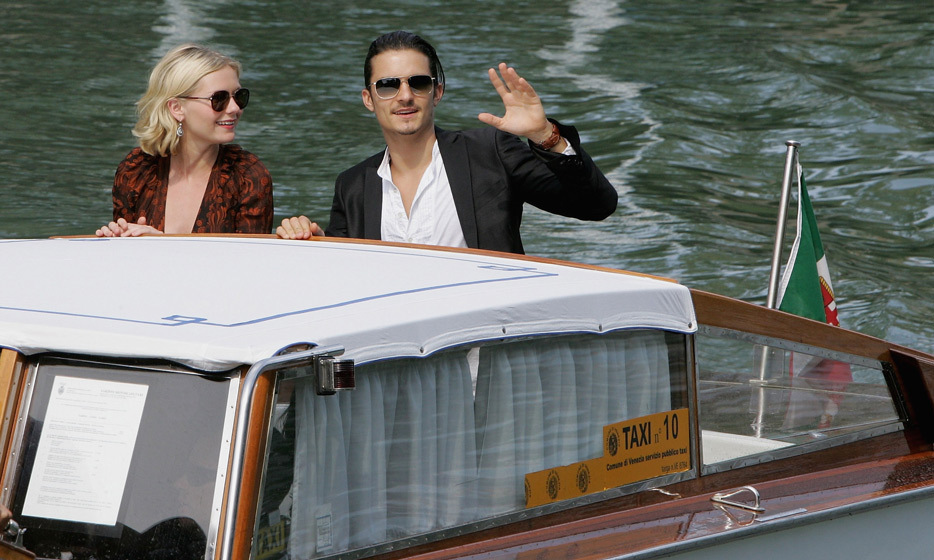 Here come the cool kids. In 2005, before the premiere of <em>Elizabethtown</em>, Kirsten Dunst and Orlando Bloom arrived on a boat wearing matching aviator sunglasses.