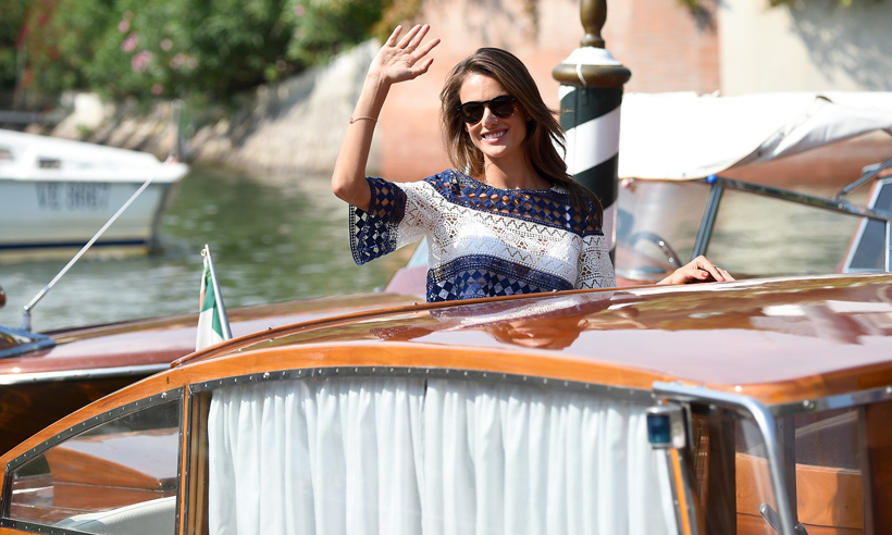 Supermodels and glitzy festivals go together like champagne and caviar, and Alessandra Ambrosio looked every inch the catwalk star waving from her water taxi at the 2015 festival. 