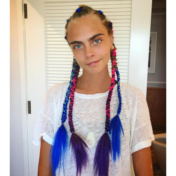 "Laura shared photos of the siblings with their ""Mad Max braids"" on Instagram, complete with colourful extensions weaved in.