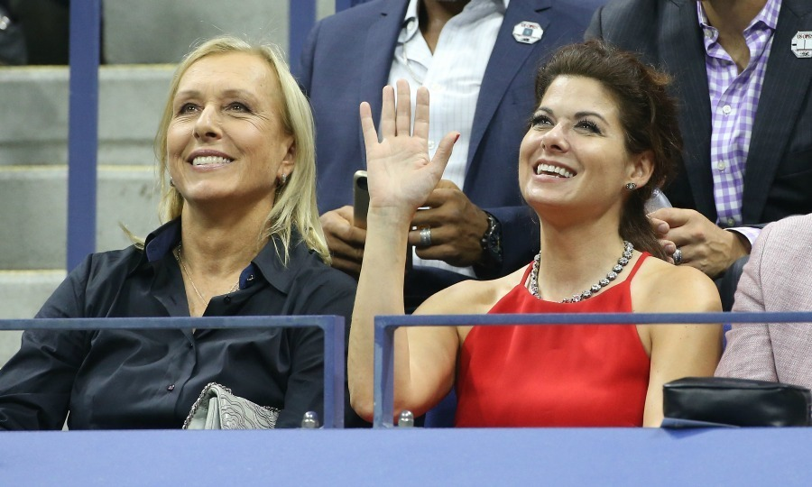 Debra Messing shot a smile and a wave to the camera alongside Martina Navratilova.