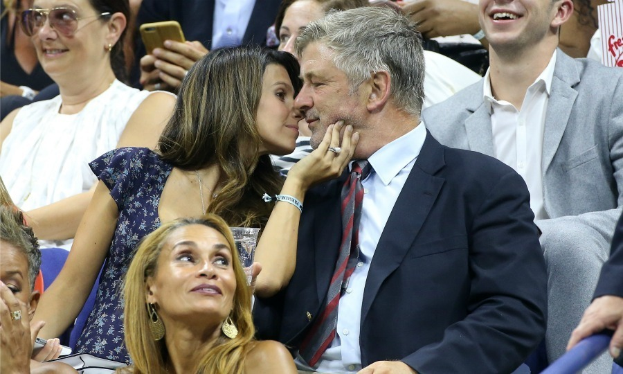 Alec Baldwin and his pregnant wife Hilaria Baldwin engaged in a little PDA during the matches.