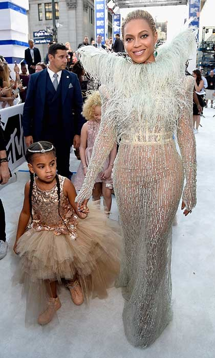 Beyoncé and Blue Ivy stole the show at the 2016 MTV VMAs in New York. Queen Bee wore an embellished Francesco Scognamiglio gown with feathered oversized wings while her little fashionista dazzled in an incredible tutu-style gown. 