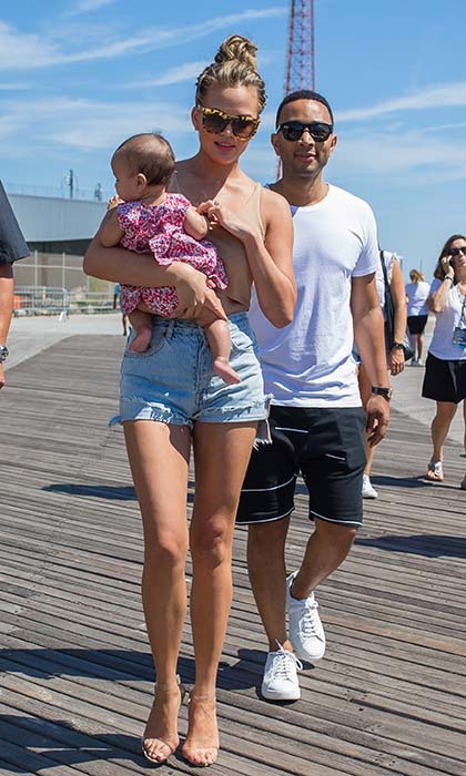 John Legend and Chrissy Teigen took their baby daughter Luna for a stroll on the boardwalk in Coney Island, New York. 
