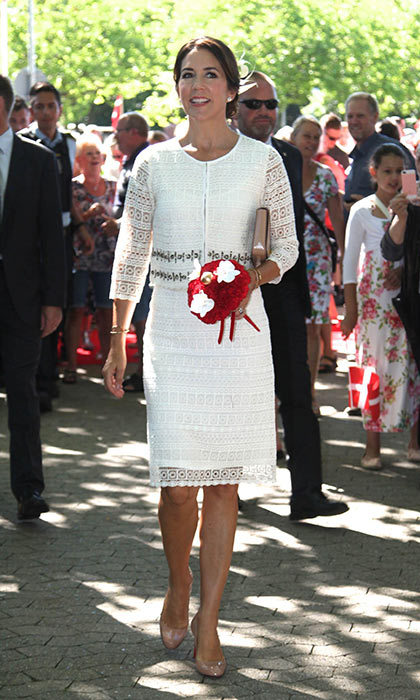 Princess Mary looked elegant in a white broderie anglaise two piece, accessorized with complementing nude heels and a clutch bag.