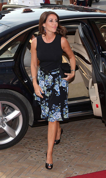The royal looked effortlessly elegant in a black tank and floral skirt to attend an event in Copenhagen.