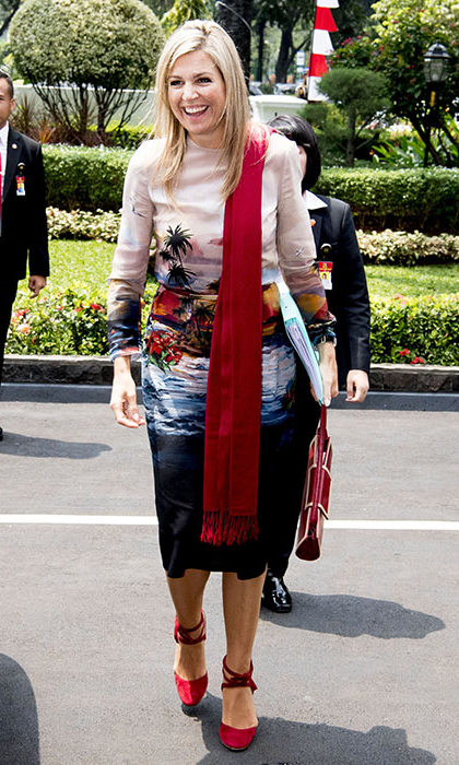 A palm print dress and red heels provided a pop of colour to Queen Maxima's look during her tour of Indonesia.