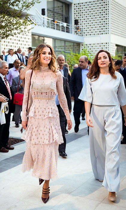Queen Rania appeared as stylish as ever in a tiered pink dress and strappy heels to attend the opening of Amman Design Week.