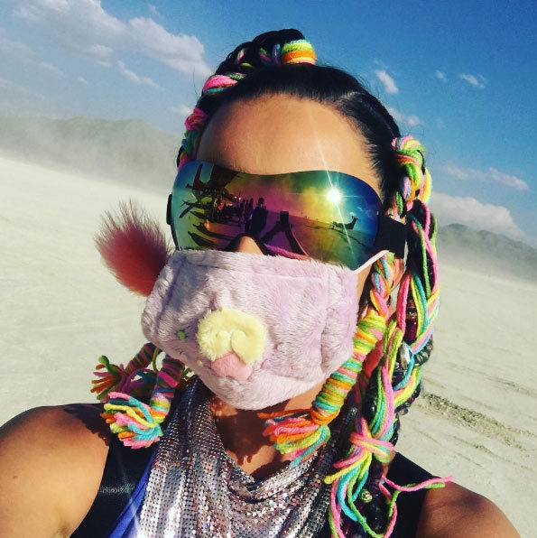 Katy Perry got into the spirit of the festival by rocking colourful braids and fluffy accessories for her time in the desert.