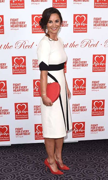 Wearing a Tabitha Webb colour block dress with a Radley clutch bag to attend a charity ball.