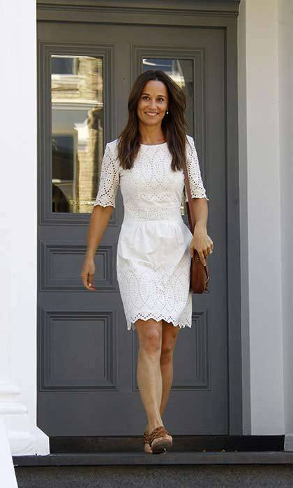 Just hours after her engagement to James Matthews was announced, Pippa proudly showed off her gorgeous ring for the first time while wearing a white embroidered Whistles dress.