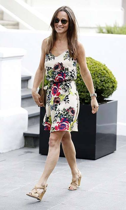 Pippa styled out the heatwave in a gorgeous floral printed silk camisole dress from ASOS, paired with Ash nude strappy wedges.