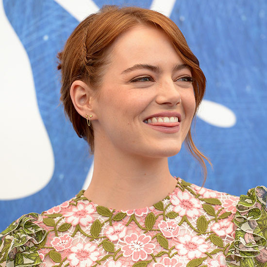 Emma Stone channelled boho chic by adding a subtle braid detail to her swept back hair, adding a dramatic side parting for daytime glamour. She showed off her radiant complexion by opting for barely-there make-up save for a hint of sparkling metallic eyeshadow.