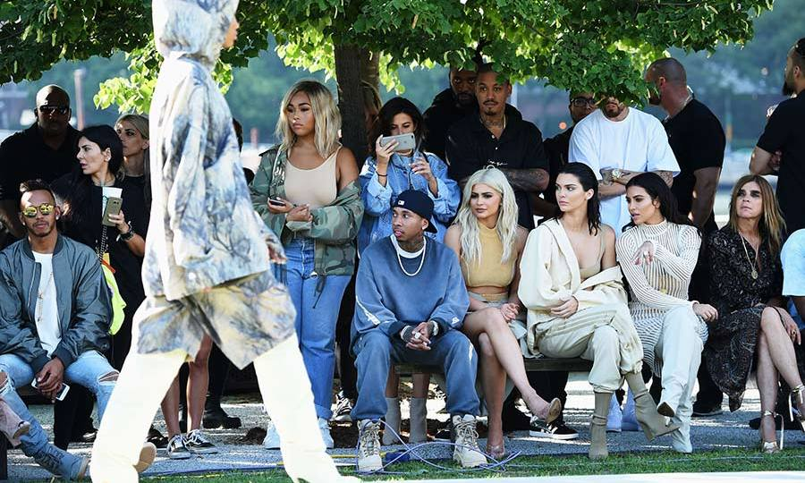 Kanye West's wife Kim Kardashian sat front row at his Yeezy show with Kendall and Kylie Jenner.
