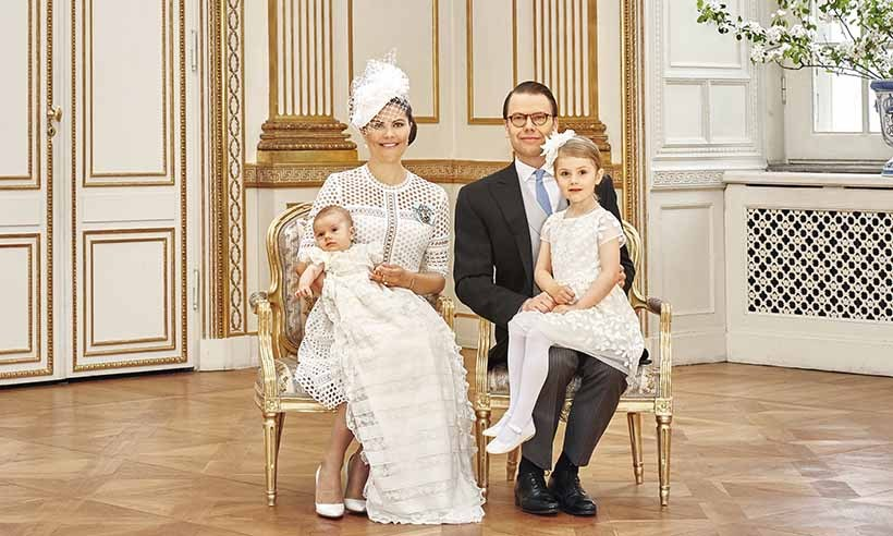 The happy family, including big sister Princess Estelle, posed for an official portrait following the service on May 27, 2016. 