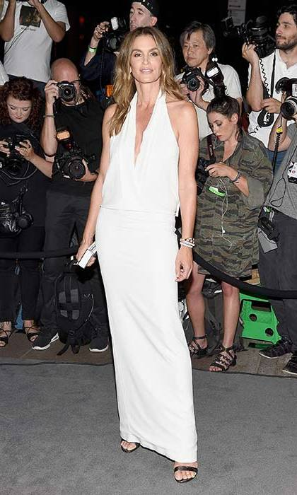 Cindy Crawford worked simple sophistication in this white Tom Ford dress.