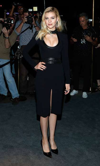 Nicola Peltz proves that all black is anything but boring in this long-sleeved bodycon dress.