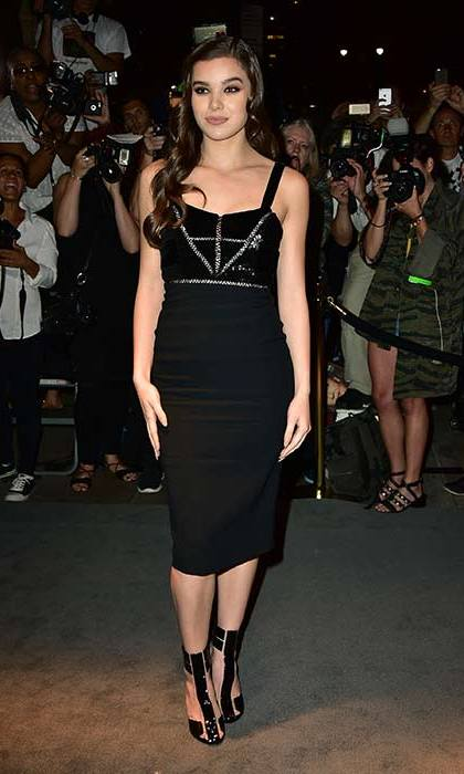 Hailee Steinfeld stunned in a figure-hugging black midi dress, with her hair worn down in loose waves.